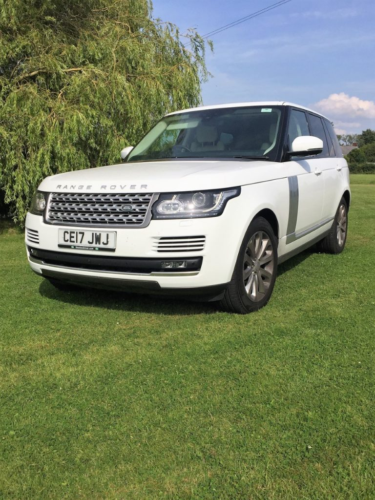 white range rover in display field